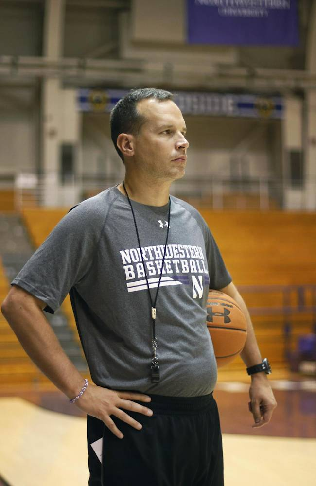 In this Monday, Oct. 28, 2013, photo, Northwestern new head basketball coach Chris Collins watches over the Wildcats' practice during an NCAA basketball team practice in Evanston, Ill. Northwestern made a sweeping change by hiring Chris Collins in the offseason. Close calls are no longer enough. The Wildcats are looking for more