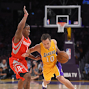 Los Angeles Lakers guard Steve Nash, right, drives past Houston Rockets guard Isaiah Canaan during the first half of an NBA basketball game, Tuesday, April 8, 2014, in Los Angeles The Associated Press