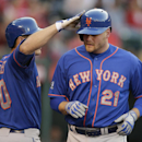 New York Mets' Lucas Duda, right, is congratulated by Anthony Recker after hitting a home run during the second inning of a baseball game against the Los Angeles Angels on Saturday, April 12, 2014, in Anaheim, Calif The Associated Press