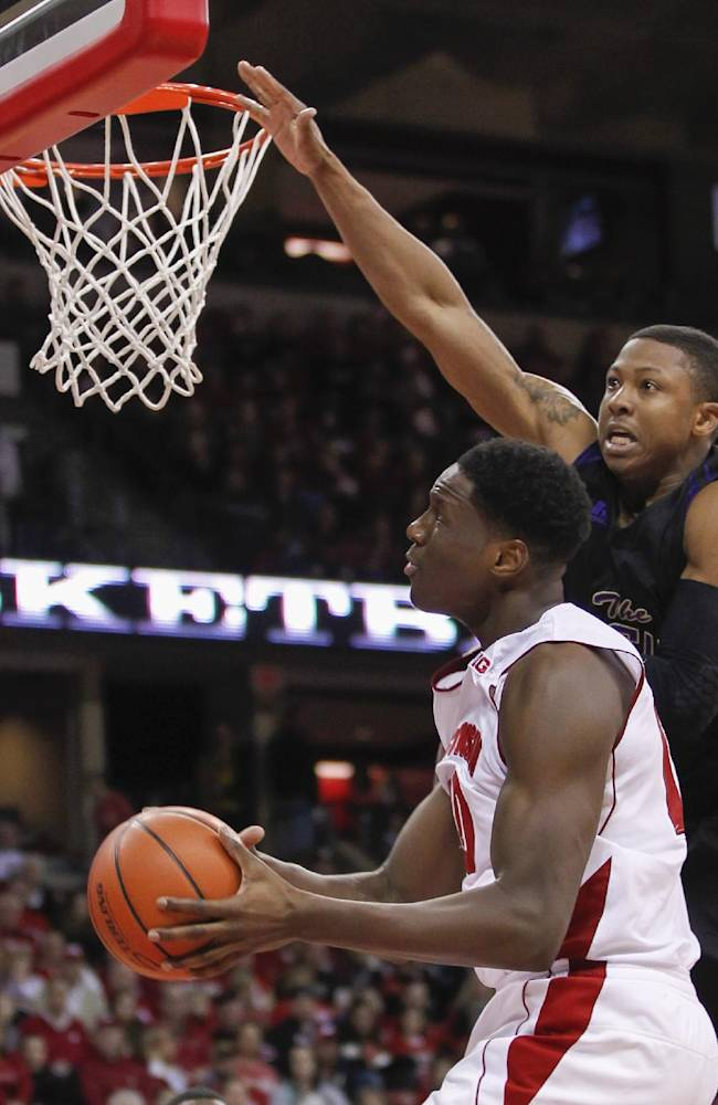 Wisconsin's Nigel Hayes shoots against Prairie View's John Brisco during the second half of an NCAA college basketball game Saturday, Dec. 28, 2013, in Madison, Wis. Wisconsin won 80-43