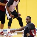 Miami Heat guard Dwyane Wade, bottom right,, stretches during NBA basketball practice, Monday, Oct. 1, 2012, in Miami. In many ways, the Heat think they're picking up in training camp where they left off in June. And that's one of many reasons why confidence around the reigning NBA champions is high these days. (AP Photo/Wilfredo Lee)