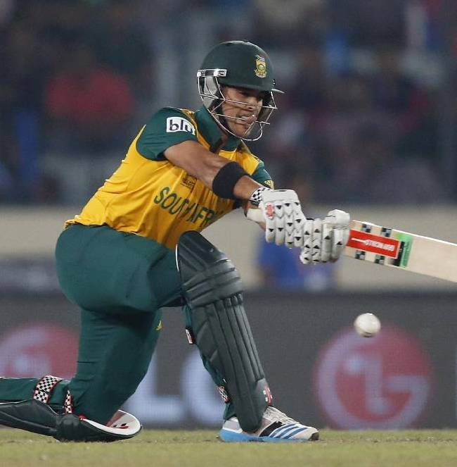 South Africa's batsman JP Duminy plays a shot during their ICC Twenty20 Cricket World Cup semi-final match against India in Dhaka, Bangladesh, Friday, April 4, 2014