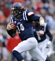 Mississippi quarterback Bo Wallace (14) runs 29-yards for a touchdown against Troy during an NCAA college football game in Oxford, Miss., Saturday, Nov. 16, 2013. (AP Photo/Oxford Eagle, Bruce Newman)