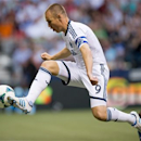 Vancouver Whitecaps' Kenny Miller, of Scotland, knocks the ball down and moves in to score a goal against the Seattle Sounders during the first half of an MLS soccer match in Vancouver, British Columbia, on Saturday, July 6, 2013. (AP Photo/The Canadian Press, Darryl Dyck)