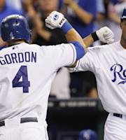 Kansas City Royals' Alex Gordon (4) is congratulated by Justin Maxwell (27) after hitting a home run in the third inning of a baseball game against the Boston Red Sox at Kauffman Stadium in Kansas City, Mo., Friday, Aug. 9, 2013. (AP Photo/Colin E. Braley)