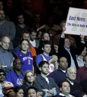 A fan holds a sign in support of New York Knicks ' Jeremy Lin during the second half of an NBA basketball game against the Dallas Mavericks in New York, Sunday, Feb. 19, 2012. The Knicks defeated the Mavericks 104-97.