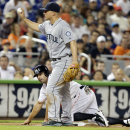Seattle Mariners third baseman Kyle Seager holds up the ball after Miami Marlins' Reed Johnson was initially ruled out at third during the ninth inning of an interleague baseball game on2 Friday, April 18, 2014, in Miami. Seager was ruled safe after a rep