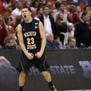 Wichita State guard Fred Van Vleet celebrates his team's 70-66 win over Ohio State in the West Regional final in the NCAA men's college basketball tournament, Saturday, March 30, 2013, in Los Angeles. (AP Photo/Jae C. Hong)
