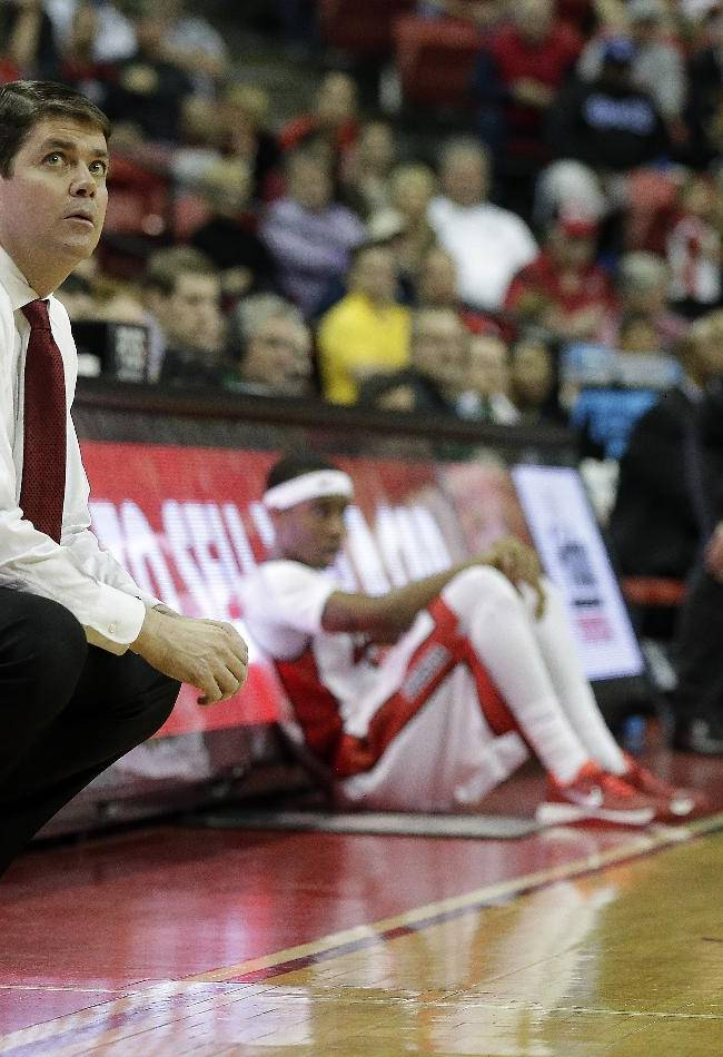 UNLV head coach Dave Rice, left, watches his team during the second half of an NCAA college basketball game against Colorado State on Wednesday, Feb. 26, 2014, in Las Vegas. UNLV defeated Colorado State 78-70