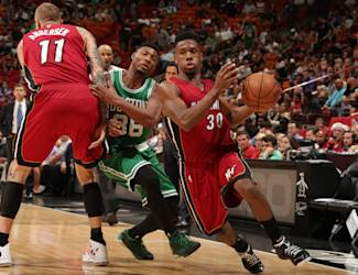MIAMI, FL - December 21: Norris Cole #30 of the Miami Heat handles the ball against the Boston Celtics on December 21, 2014 at American Airlines Arena in Miami, Florida. (Photo by Isaac Baldizon/NBAE via Getty Images)
