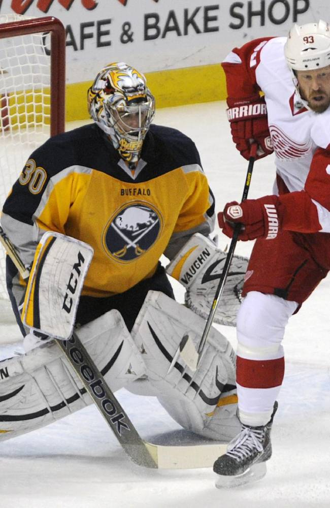 Buffalo Sabres goaltender Ryan Miller (30) reacts as Detroit Red Wings right winger Johan Franzen (93), of Sweden, tries to deflect the puck during the first period of an NHL hockey game in Buffalo, N.Y., Sunday, Nov. 24, 2013
