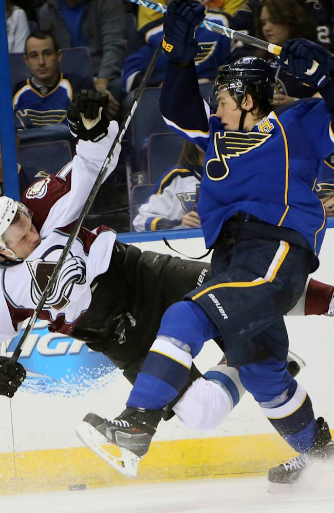 St. Louis Blues right wing T.J. Oshie, right, collides with Colorado Avalanche left wing Jamie McGinn during the second period of an NHL hockey game, Thursday, Nov. 14, 2013, in St. Louis