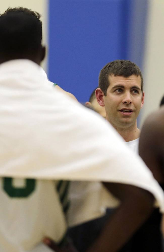 Boston Celtics head coach Brad Stevens, center, talks with his players during NBA basketball training camp at Salve Regina University, Tuesday, Oct. 1, 2013, in Newport, R.I