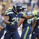 Seattle Seahawks' Marshawn Lynch (24) reacts after scoring on a carry against the Chicago Bears in the first half of a preseason NFL football game, Friday, Aug. 22, 2014, in Seattle The Associated Press