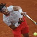 Rafael Nadal of Spain serves against Slovakia's Martin Klizan in their second round match at the French Open tennis tournament, at Roland Garros stadium in Paris, Friday, May 31, 2013. (AP Photo/Michel Spingler)