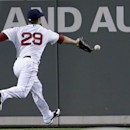 Boston Red Sox left fielder Daniel Nava (29) chases down a double by Nate Hanson in the seventh inning of an exhibition baseball game in Fort Myers, Fla., Thursday, March 27, 2014. The Red Sox won 4-1 The Associated Press