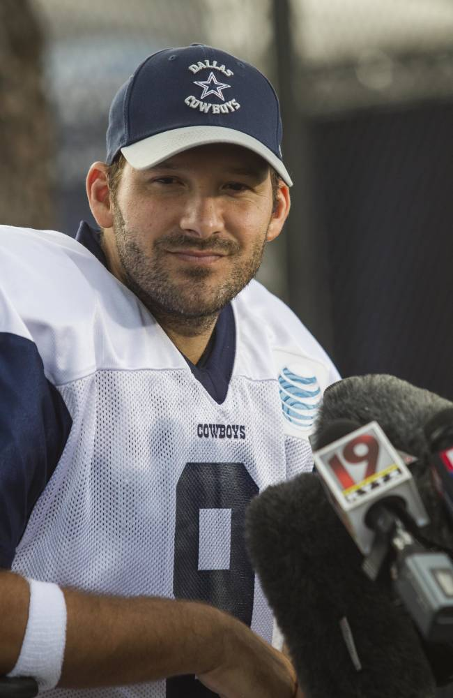 Dallas Cowboys quarterback Tony Romo  interviewed by media after a practice at NFL football training camp, Wednesday, July 30, 2014, in Oxnard, Calif