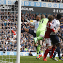 Tottenham Hotspur's Younes Kaboul, left, scores against Fulham during their English Premier League soccer match at White Hart Lane, London, Saturday, April 19, 2014