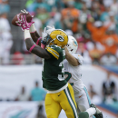 Green Bay Packers cornerback Sam Shields (37) intercepts a pass intended for Miami Dolphins wide receiver Brian Hartline (82) during the first half of an NFL football game, Sunday, Oct. 12, 2014, in Miami Gardens, Fla The Associated Press