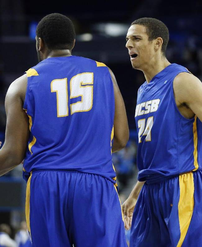 CORRECTS NAME OF PLAYER AT LEFT - UC Santa Barbara's Michael Bryson, right, celebrates after Alan Williams, left, scored while drawing a foul from UCLA's Wanaah Bail during the first half of an NCAA college basketball game, Tuesday, Dec. 3, 2013, in Los Angeles