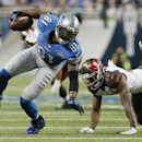 Detroit Lions wide receiver Calvin Johnson (81) recovers his balance while defended by Tampa Bay Buccaneers cornerback Johnthan Banks (27) during the second half of an NFL football game in Detroit, Sunday, Dec. 7, 2014 The Associated Press