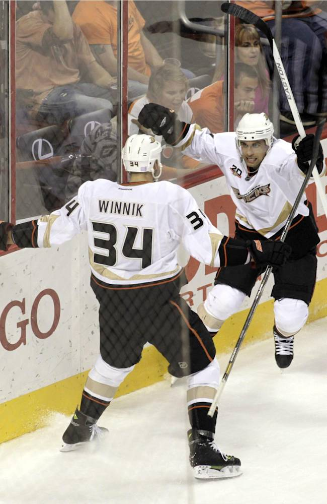Anaheim Ducks' Andrew Cogliano, right celebrates with Daniel Winnik (34) after scoring against the Philadelphia Flyers in the second period of an NHL hockey game, Tuesday Oct. 29, 2013, in Philadelphia