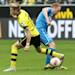 Dortmund's Marco Reus, left, and Hoffenheim's Patrick Ochs challenge for the ball during the German first division Bundesliga soccer match between Borussia Dortmund and TSG 1899 Hoffenheim in Dortmund, Germany, Saturday, May 18, 2013