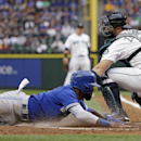 Toronto Blue Jays' Jose Reyes, left, scores as Seattle Mariners catcher Mike Zunino turns toward him for the tag during the first inning of a baseball game Friday, July 24, 2015, in Seattle. (AP Photo/Elaine Thompson)