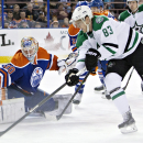 Dallas Stars' Ales Hemsky (83) is stopped by Edmonton Oilers goalie Ben Scrivens (30) during the first period of an NHL hockey action in Edmonton, Alberta, on Sunday, Dec. 21, 2014. (AP Photo/The Canadian Press, Jason Franson)