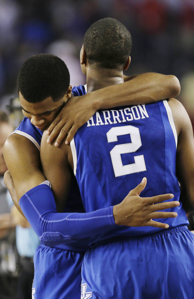 After Kentucky guard Aaron Harrison (2) made a three-point basket in the final seconds against Wisconsin to win the game 74-73, he is embraced guard Andrew Harrison after their NCAA Final Four tournament college basketball semifinal game Saturday, April 5, 2014, in Arlington, Texas