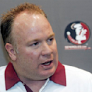FILE - In this Aug. 12, 2012, file photo, Florida State defensive coordinator Mark Stoops is interviewed during the Seminoles' football media day in Tallahassee, Fla. Kentucky has hired Florida State defensive coordinator Mark Stoops as its new football coach. The university announced Tuesday, Nov. 27, 2012 that Stoops will replace Joker Phillips, who was fired on Nov. 4. (AP Photo/Phil Sears, File)