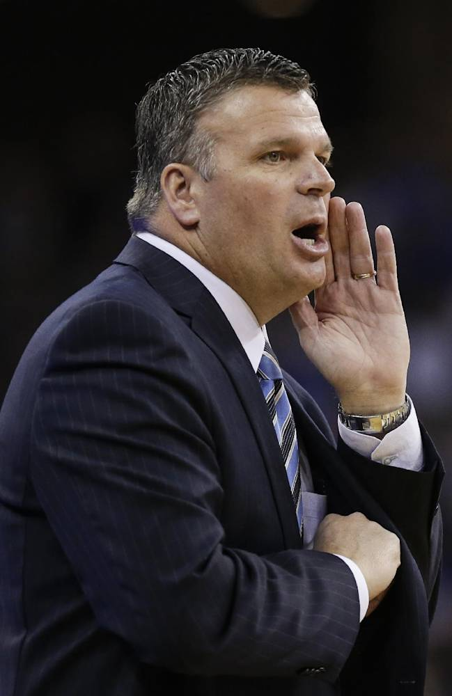 In this Jan. 5, 2013 file photo, Creighton coach Greg McDermott calls out instructions during an NCAA college basketball game against Indiana State, in Omaha, Neb. Two-time first-team All-American Doug McDermott leads Creighton into the Big East. He has plenty of company from last season's Missouri Valley Conference championship team coming with him
