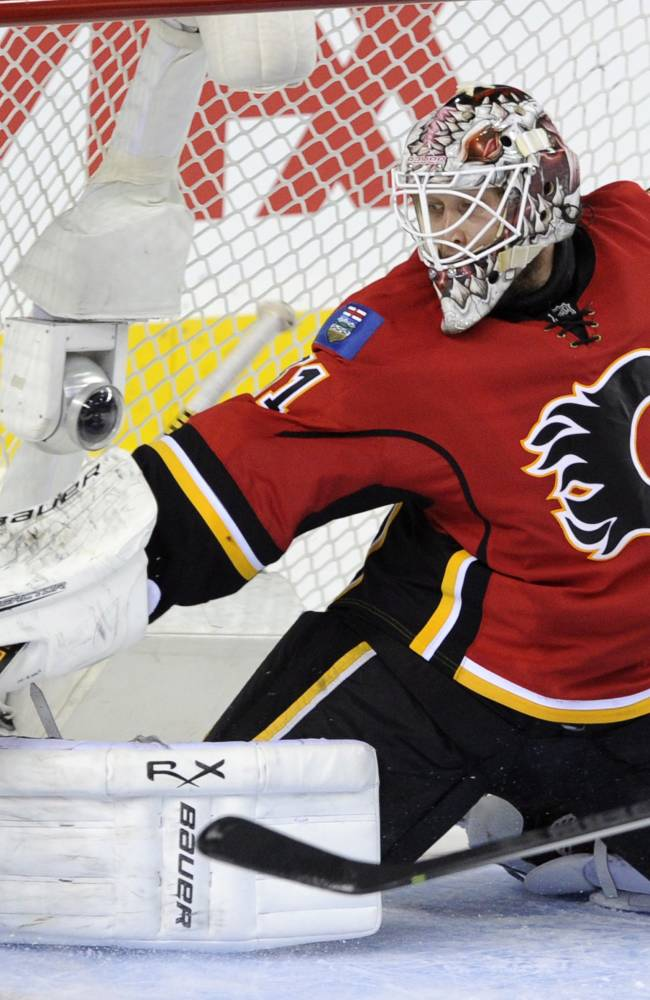 Calgary Flames goalie Karri Ramo makes a save against the Washington Capitals during third period NHL action in Calgary, Alta., Saturday, October 26, 2013. Calgary went on to win 5-2