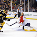 Boston Bruins' Brad Marchand (63) scores the game-winning goal in Florida Panthers' Roberto Luongo (1) during overtime in an NHL hockey game in Boston, Tuesday, Nov. 4, 2014. The Bruins won 2-1 The Associated Press
