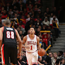CHICAGO, IL - DECEMBER 12: Derrick Rose #1 of the Chicago Bulls brings the ball up court against Nicolas Batum #88 of the Portland Trail Blazers on December 12, 2014 at the United Center in Chicago, Illinois. (Photo by Gary Dineen/NBAE via Getty Images)