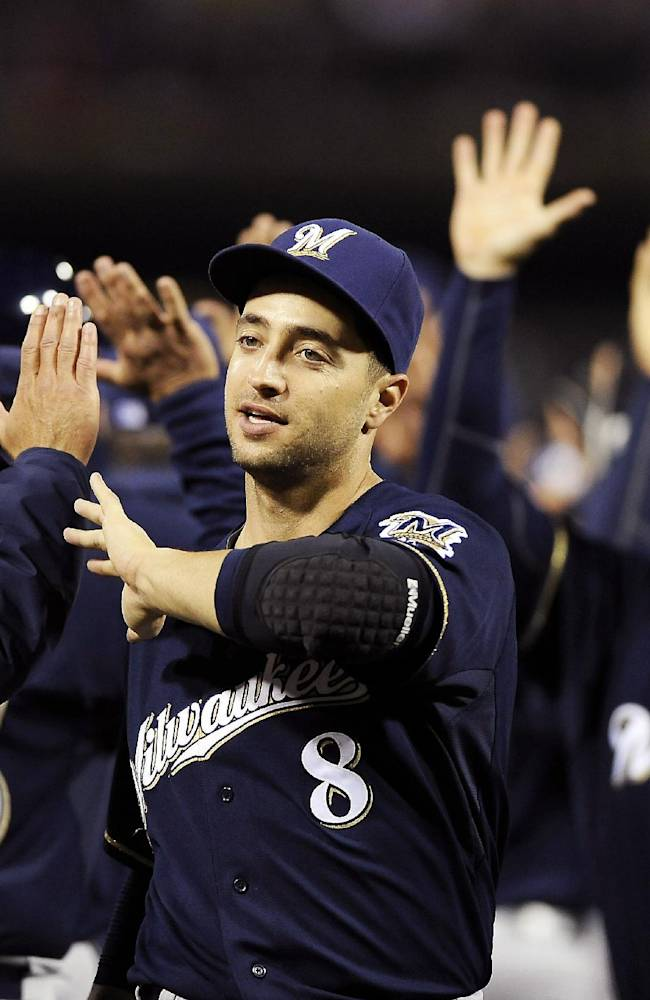 Milwaukee Brewers' Ryan Braun (8) celebrates with teammates at the end of a baseball game against the Philadelphia Phillies, Wednesday, April 9, 2014, in Philadelphia. The Brewers won 9-4