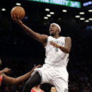 Brooklyn Nets' Andray Blatche drives to the basket during the first half of an NBA basketball game against the Chicago Bulls, Monday, March 3, 2014, in New York The Associated Press