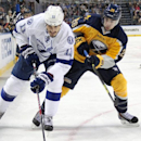 Buffalo Sabres' Matt Moulson (26) and Tampa Bay Lightning's Brian Boyle (11) battle for the puck during the second period of an NHL hockey game Tuesday, Dec. 2, 2014, in Buffalo, N.Y The Associated Press