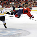 Washington Capitals right wing Alex Ovechkin (8), of Russia, goes airborne after he was tripped up by Boston Bruins center Patrice Bergeron (37) during the first period of an NHL hockey game, Saturday, March 29, 2014, in Washington The Associated Press