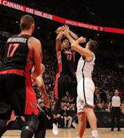 TORONTO, CANADA - January 11: DeMar DeRozan #10 of the Toronto Raptors shoots the ball against the Brooklyn Nets during the game on January 11, 2014 at the Air Canada Centre in Toronto, Ontario, Canada. (Photo by Ron Turenne/NBAE via Getty Images)