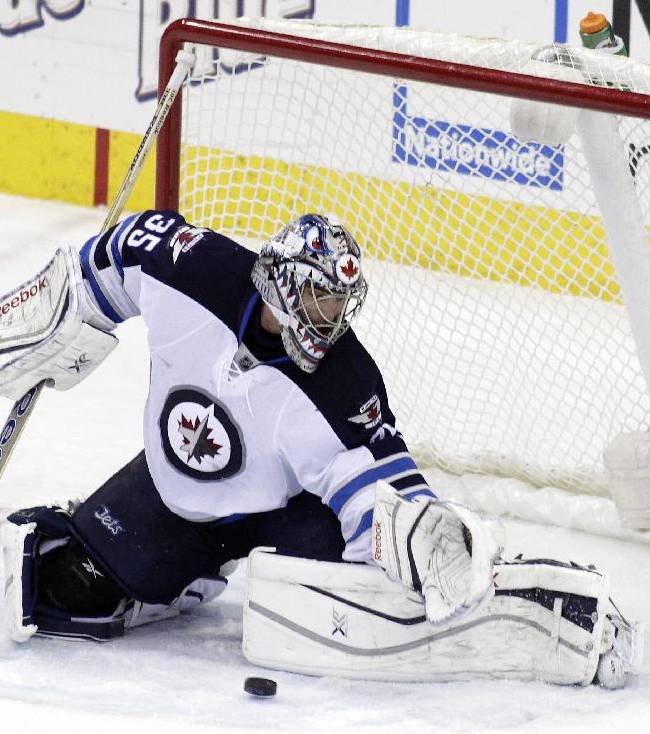 Winnipeg Jets' Al Montoya makes a save against the Columbus Blue Jackets during the third period of an NHL hockey game Monday, Dec. 16, 2013, in Columbus, Ohio. The Jets won 3-2