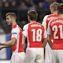 Arsenal's Jack Wilshere, right, turns and talks to teammates during the Group D Champions League match between Anderlecht and Arsenal at Constant Vanden Stock Stadium in Brussels, Belgium, Wednesday Oct. 22, 2014