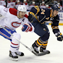 Buffalo Sabres' Tyson Strachan (24) and Montreal Canadiens' Max Pacioretty (67) chase the puck during the second period of an NHL hockey game Wednesday, Nov. 5, 2014, in Buffalo, N.Y. Montreal defeated Buffalo 2-1 in a shootout The Associated Press