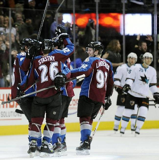 The Colorado Avalanche celebrate a goal by Colorado Avalanche defenseman Erik Johnson in the second period of an NHL hockey game against the San Jose Sharks on Saturday, Jan. 4, 2014, in Denver