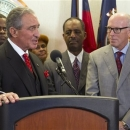 Atlanta Falcons owner Arthur Blank, left, speaks while team President and CEO Rich McKay listens during a news conference Thursday, March 7, 2013, in Atlanta, at which team and government officials announced that financing terms have been reached for the Falcons' proposal to build a new $1 billion stadium, keeping the NFL football team's home games in the city's downtown. (AP Photo/Todd Kirkland)