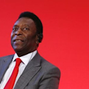 Brazilian soccer legend Pele attends a news conference to present the FIFA World Cup global