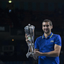 Croatia's Marin Cilic holds the trophy after defeating Spain's Roberto Bautista Agut at the final match at the Kremlin Cup tennis tournament in Moscow in Moscow, Russia, Sunday, Oct. 19, 2014. (AP Photo/Pavel Golovkin)