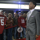 Florida State quarterback Jameis Winston walks down the red carpet after arriving for the College Football Awards show in Lake Buena Vista, Fla., Thursday, Dec. 12, 2013.(AP Photo/Phelan M. Ebenhack)