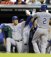Kansas City Royals manager Ned Yost (3) congratulates Alcides Escobar (2) after Escobar hit a solo home run off Cleveland Indians starting pitcher Zach McAllister in the fifth inning of a baseball game, Tuesday, Sept. 10, 2013, in Cleveland. (AP Photo/Tony Dejak)