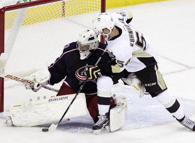 Columbus Blue Jackets' Oscar Dansk, left, of Sweden, makes a save against Pittsburgh Penguins' Tom Kuhnhacki, of Germany, during the third period of an NHL preseason hockey game, Sunday, Sept. 15, 2013, in Columbus, Ohio. The Blue Jackets beat the Penguins 5-4
